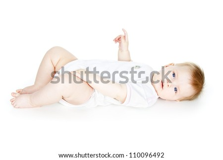 lies a beautiful baby isolated on white background - stock photo