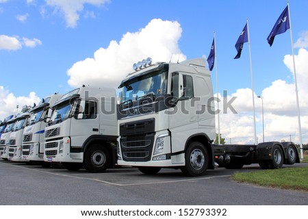 LIETO, FINLAND - AUGUST 31: White Volvo trucks on August 31, 2013 in Lieto, Finland. With its companies Volvo Trucks and Renault Trucks, the Volvo Group has over 1 million trucks operating in Europe.  - stock photo