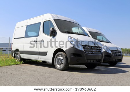 LIETO, FINLAND -?? MAY 24, 2014: Third generation of Two Renault Master Crew vans parked. Renault Trucks presents the new Renault Master at the CV show in Birmingham. - stock photo