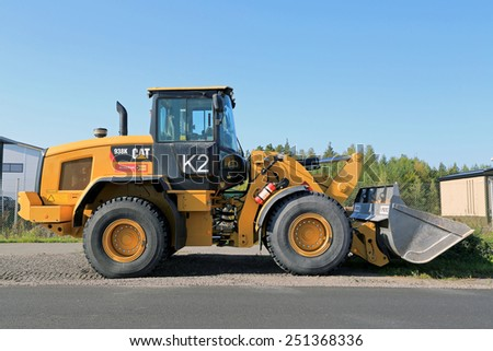 LIETO, FINLAND - SEPTEMBER 13, 2014: CAT 938K Wheel loader. The 938K has a Tier 4-Interim engine that can save up to 30 percent on fuel compared with the H Series predecessors. - stock photo
