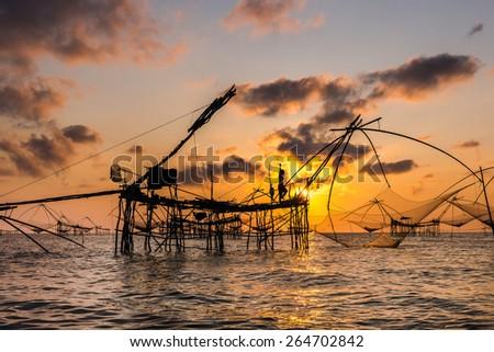 Life asian fisherman and bamboo machinery  - stock photo