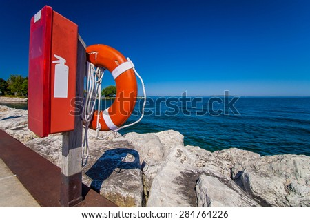 Life buoy and fire hydrant hanging on the wooden pole