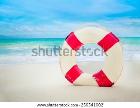 Life buoy at the beach - stock photo