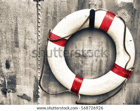 life buoy attached to a metal wall on a ship - stock photo