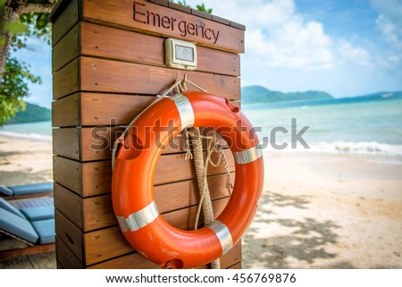 Life buoy hanging on wooden wall for emergency response when people sinking to water almost place near pool and beach