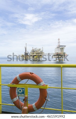 Life buoy with signage isolated with oil rig platform