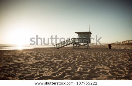 Life Guard Tower at Sunset Vintage Retro Filter - stock photo