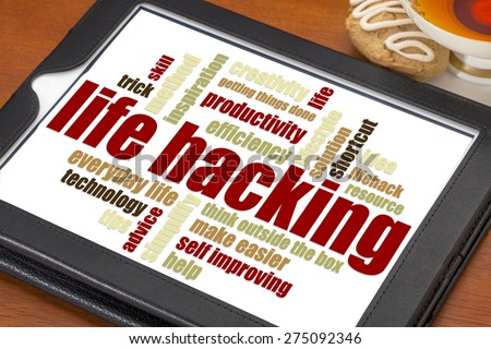 life hacking word cloud on a digital tablet with cup of tea - stock photo