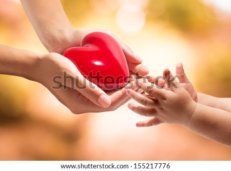 life in your hands - heart whit orange background - stock photo