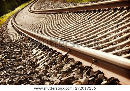 Life is a journey as a thought. Image of a curve on an empty railroad. Also image has a vintage effect. - stock photo