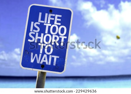 Life is Too Short To Wait sign with a beach on background - stock photo