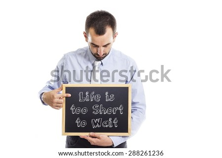 Life is too short to wait -Young businessman with blackboard - isolated on white - stock photo