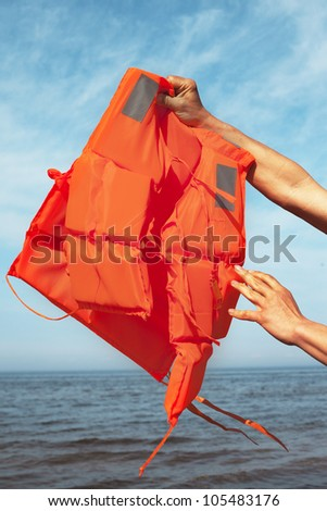 Life jacket against sea and sky.