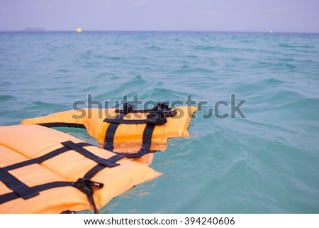 Life jackets were dumped in the sea. Safety at sea is not interested. This could be an accident, even death.    - stock photo