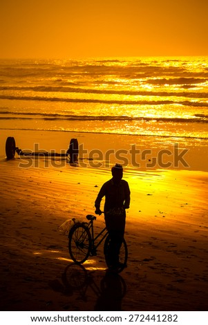 Life of fishermen in sunrise on the beach, vietnam - stock photo