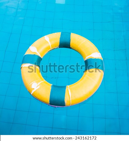 Life preserver floating in a  swimming pool - stock photo