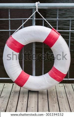 Life preserver floating near deep water pool - stock photo