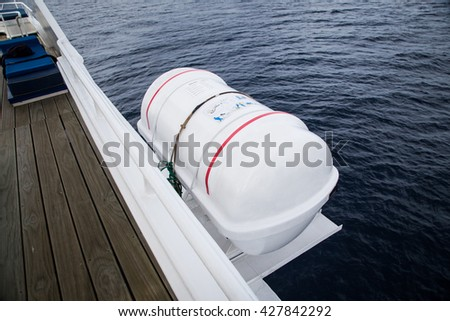 Life raft with manual inflatable for emergency use to escape. - stock photo