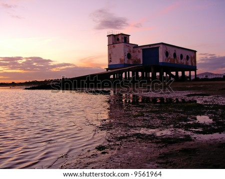 Life saver house on the beach of Fuseta village near Olhão, Portugal. - stock photo