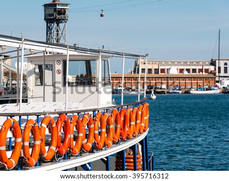 life saver rings on a boat in barcelona harbour - stock photo