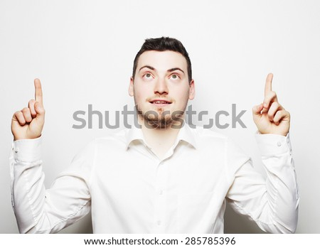 life style, business  and people concept: business man pointing up finger. Isolated on white background/ - stock photo