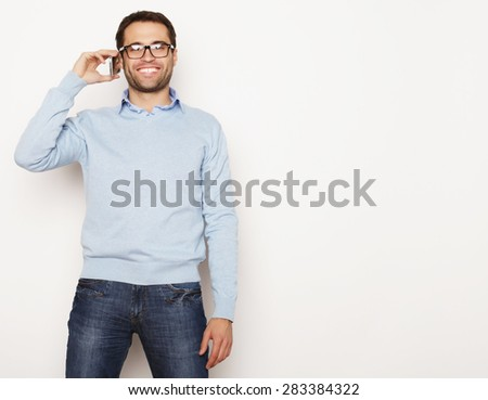 life style, business  and people concept: Young business man using mobile phone.Over white background. - stock photo