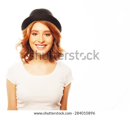 life style, happiness, emotional and people concept: Beautiful young  woman wearing white shirt and black hat looking at camera and make different emotions while standing against white background - stock photo
