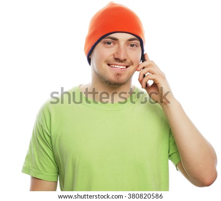 life style, tehnology and people concept: cheerful man in shirt speaking on the phone, isolated on white - stock photo