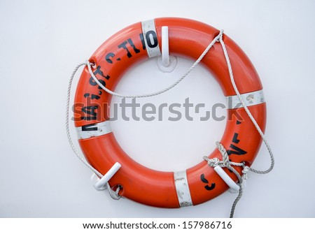 Life vest on white wall - stock photo