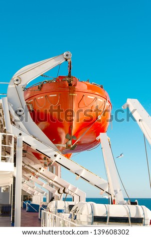 Lifeboat on a cruise ship - stock photo