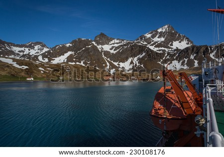 Lifeboat on board a ship in the harbor in front of Grytviken Whaling Station on South Georgia - stock photo