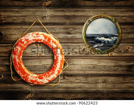 lifebuoy and porthole with sea view - stock photo