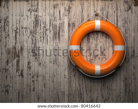 Lifebuoy attached to a wooden wall - stock photo