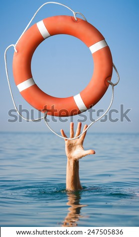 Lifebuoy for man in danger. Rescue situation concept - stock photo