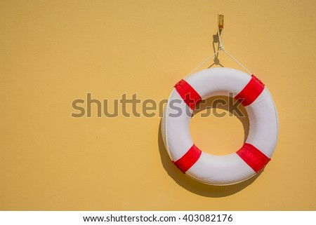 Lifebuoy hanging on a wall - stock photo