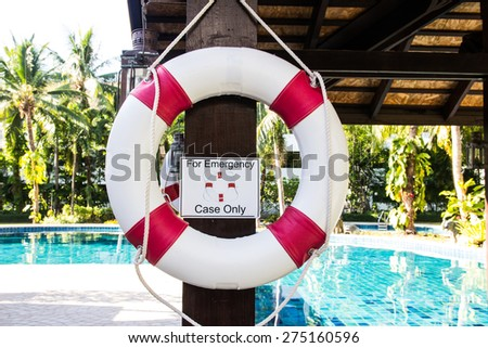 Lifebuoy hanging on pole - stock photo