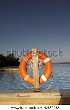 Lifebuoy on a dock/platform in Kandooma, Maldives - stock photo