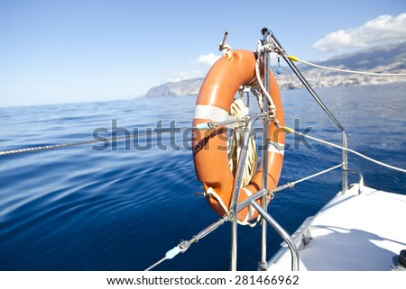lifebuoy on catamaran sailboat - stock photo