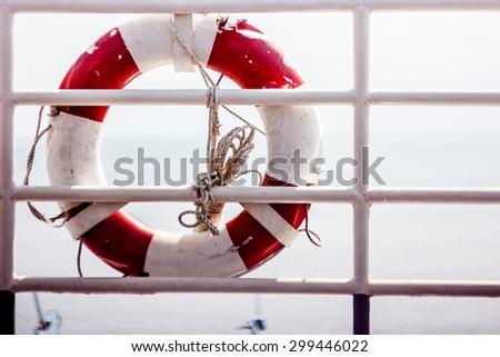 lifebuoy on the railing of the ship - stock photo
