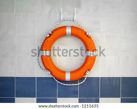 Lifebuoy on wall - stock photo