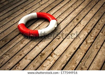 lifebuoy, red stripes - stock photo