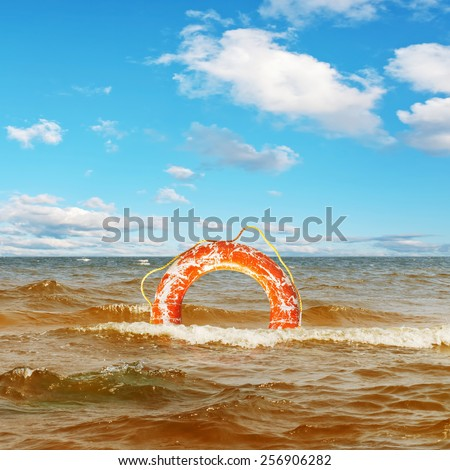 Lifebuoy Ring In The Sea Under Blue Sky  - stock photo