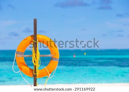 Lifebuoy ring on tropical white beach  - stock photo