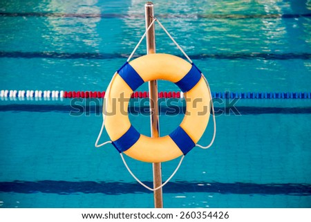 Lifebuoy safety in swimming pool - stock photo