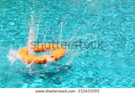 lifebuoy splash the water in the pool - stock photo