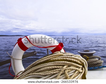 Lifebuoy,  Winch, halyard on the Board - stock photo