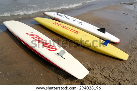Lifeguard and Rescue Signs on Surfboards  - stock photo