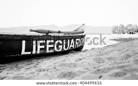 lifeguard boat on a beach black and white - stock photo