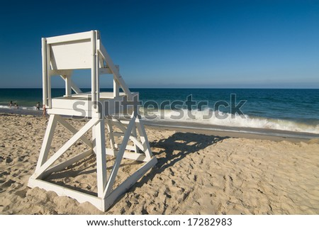 Lifeguard chair on a perfect beach - stock photo