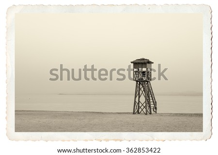 Lifeguard chair on beach on old postcard vintage style  - stock photo